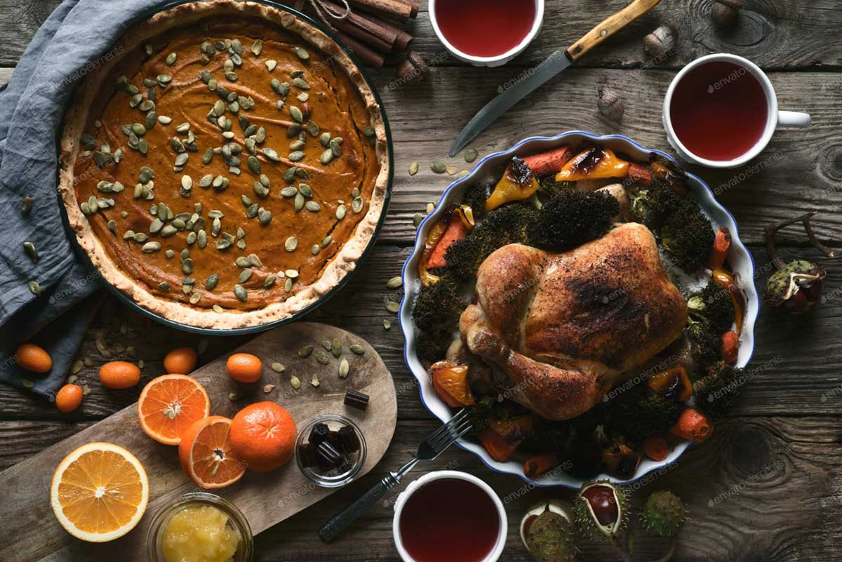 Wooden table served for Thanksgiving dinner top view